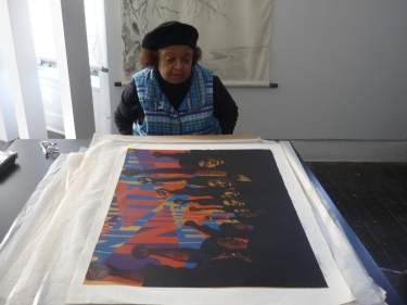"Barbara Jones-Hogu examining the first version of her print ""Unite"""