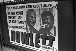 Truth Bubble stickers placed on political sign, ca. 1979